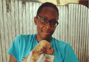 Dr. Kendra Simons with a Puppy