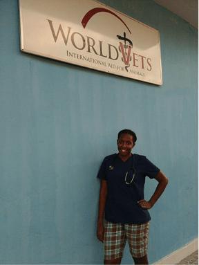Dr. Kendra Simons posing under World Vets sign